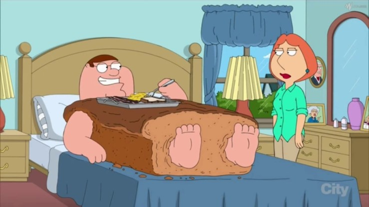 Peter Griffin is encased in a loaf of bread eating breakfast.